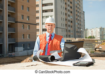 Portrait of white-collar worker wearing protective helmet ...