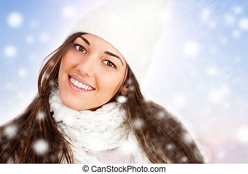 Portrait of Winter girl with snowflakes.