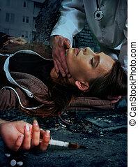 Portrait of woman addicted to syringe on brick wall...