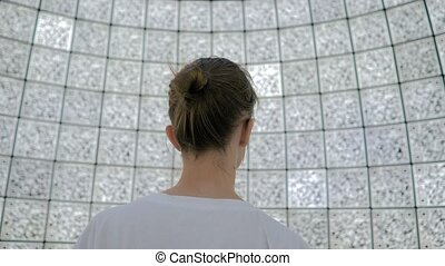 Portrait of woman against wall with qr codes at futuristic ...