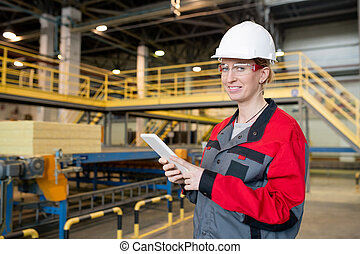 Portrait of woman at construction plant
