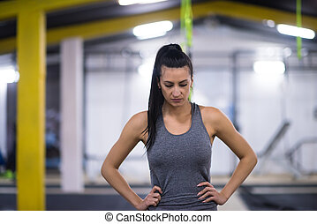 portrait of woman at cross fitness gym