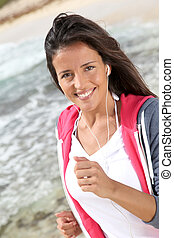 Portrait of woman doing exercises by the beach