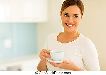 woman drinking tea at home