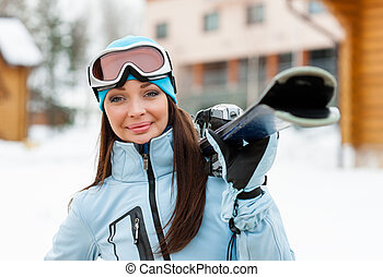 Portrait of woman handing skis
