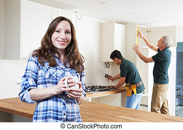 Portrait Of Woman Having New Kitchen Fitted