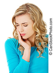 Portrait of woman having strong toothache