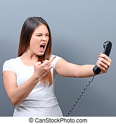 Portrait of woman having unpleasant phone calll and showing ...