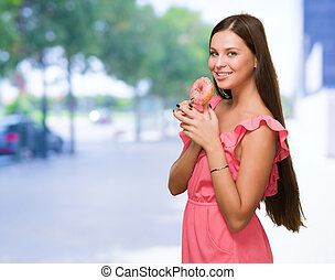 Portrait Of Woman Holding Doughnut