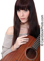 portrait of woman holding guitar