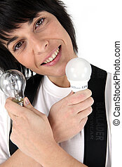 Portrait of woman holding two light bulbs
