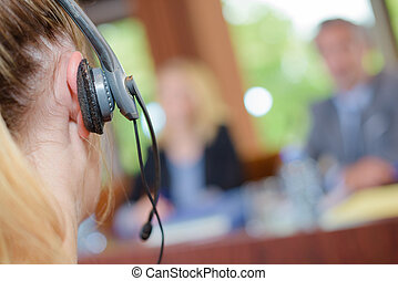 portrait of woman in a call center with phone headset