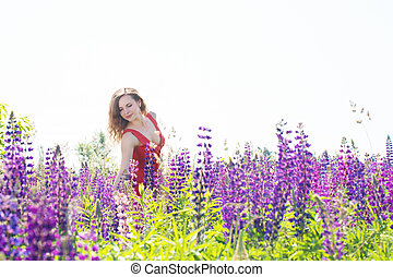 Portrait of woman in a field of lupines