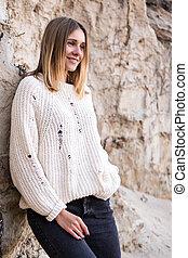 Portrait of woman in a sweater