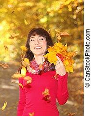 Portrait of woman in autumn park