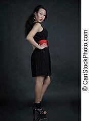 Portrait of woman in black dress