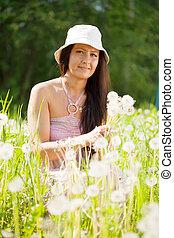 woman in dandelion plant