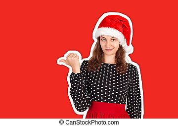 portrait of woman in dress pointing left with thumb and upset. emotional girl in santa claus christmas hat Magazine collage style with trendy color background. holiday concept