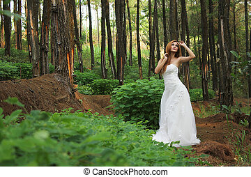 Portrait of woman in fairy forest