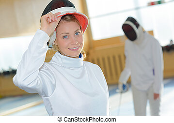 Portrait of woman in fencing suit