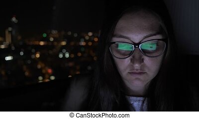 Portrait of woman in glasses working on computer near the...