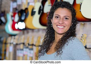 Portrait of woman in music shop
