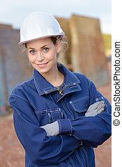 Portrait of woman in overalls and hardhat