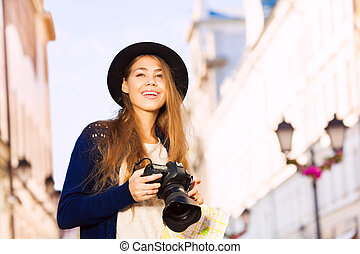 Portrait of woman in retro outfit with camera
