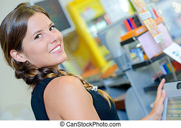Portrait of woman in stationery store