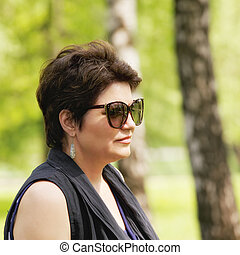 Portrait of woman in sunglasses