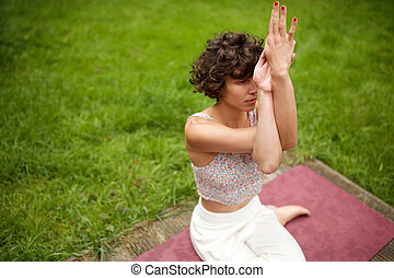 woman in yoga pose in park