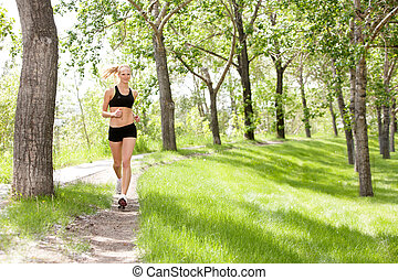 Portrait of a young beautiful smiling woman jogging