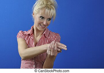 Portrait of woman miming gesture of holding a gun