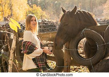 Portrait of woman near a horse