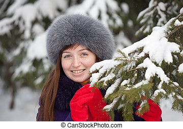 woman near fir-tree in winter