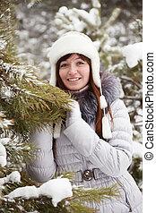 woman near pine tree in winter