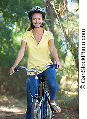 Portrait of woman on bicycle