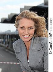 Portrait of woman on bridge