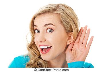Portrait of woman overhearing a conversation