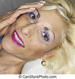 Portrait of woman. - Portrait of tan Caucasion blonde middle...