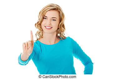 Portrait of woman pushing imaginary button