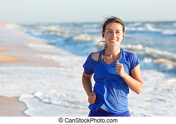 portrait of woman running by the ocean or sea beach