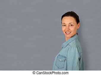 Portrait of woman standing on grey background