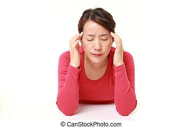 woman suffers from headache