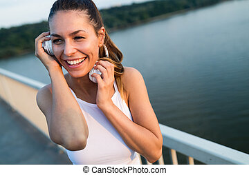 Portrait of woman taking break from jogging