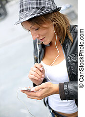 Portrait of woman using smartphone in town