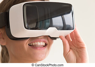 Portrait of woman using virtual reality glasses