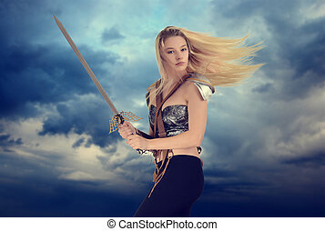 woman warrior with cloudy sky background - portrait of woman...