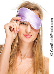Portrait of woman wearing a sleeping mask