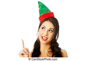 Portrait of woman wearing elf clothes pointing up